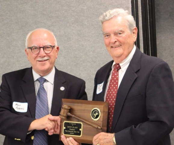 Incoming President Max Adams presents plaque to Outgoing President David Bland